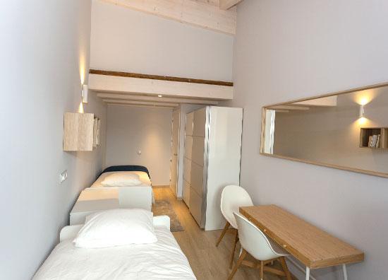 Habitación dos camas alojamiento La Casa de los Mil Años